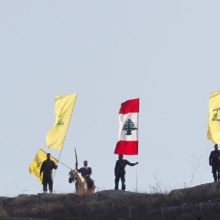 FILE PHOTO: Members of Lebanon's Hezbollah wave Hezbollah and Lebanese flags during a rally marking the ninth anniversary of the end of Hezbollah's 2006 war with Israel, in Wadi al-Hujeir, southern Lebanon August 14, 2015. REUTERS/Aziz Taher/File Photo