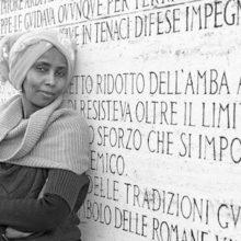 Rome November 25, 2013. Safia Omar Mamoud Somali migrants photographed on deck Amedeo D'Aosta/ Safia Omar Mamoud migrante somala fotografata sul Ponte Amedeo D'Aosta a Roma. Photo: RINO BIANCHI